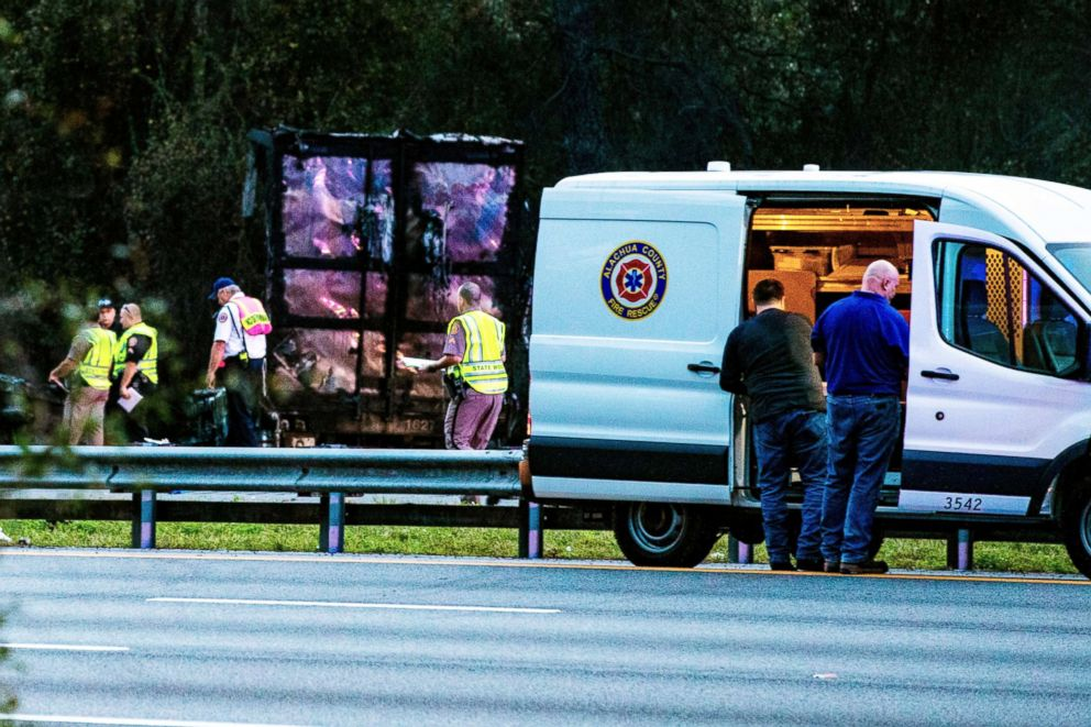 PHOTO: Police survey the scene after a wreck with multiple fatalities on Interstate 75, south of Alachua, near Gainesville, Fa., Jan. 3, 2019.