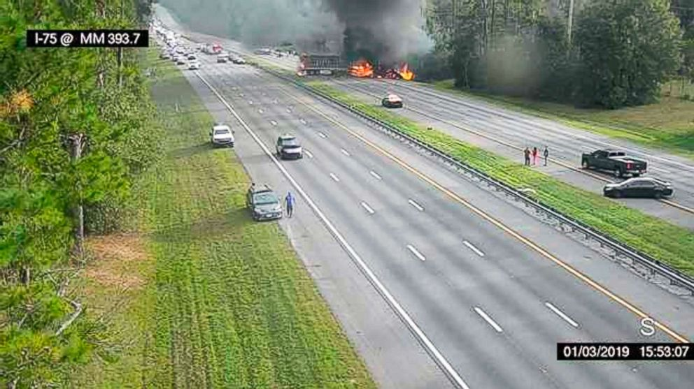 PHOTO: This image taken from a Florida 511 traffic camera and provided by the Alachua County Fire Rescue, shows a fiery crash along Interstate 75, about a mile south of Alachua, near Gainesville, Fla., Jan. 3, 2019.