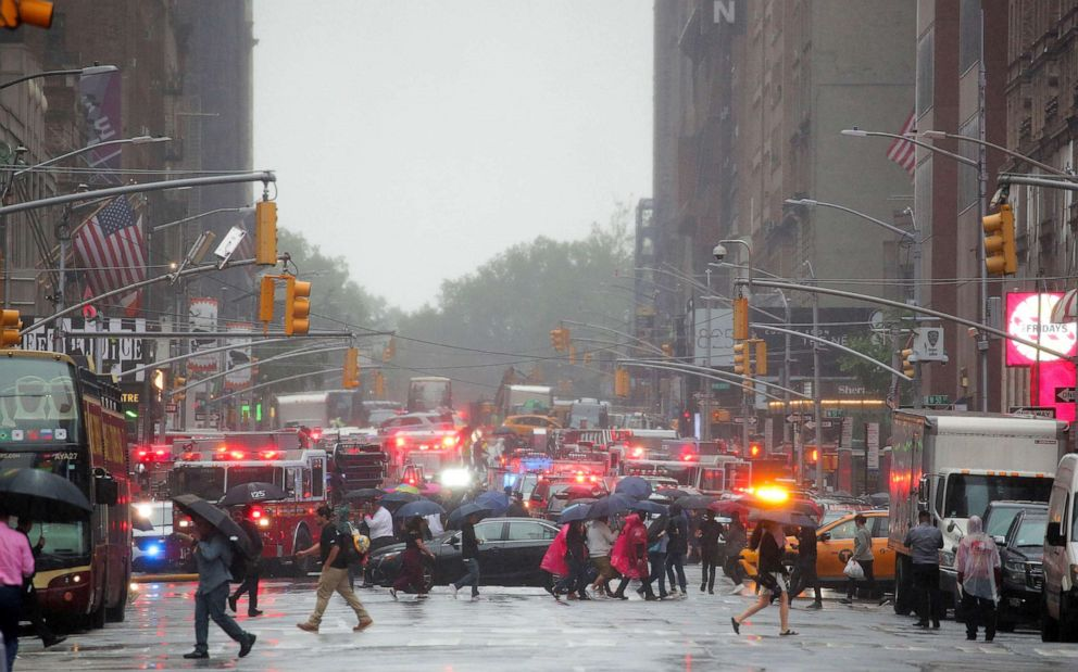 PHOTO: Emergency vehicles fill the street at the scene after a helicopter crashed atop a building in Times Square and caused a fire in the Manhattan borough of New York, June 11, 2019.