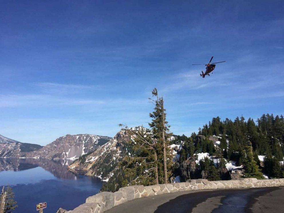 PHOTO: A U.S. Coast Guard helicopter flies over Crater Lake in Oregon, June 10, 2019.