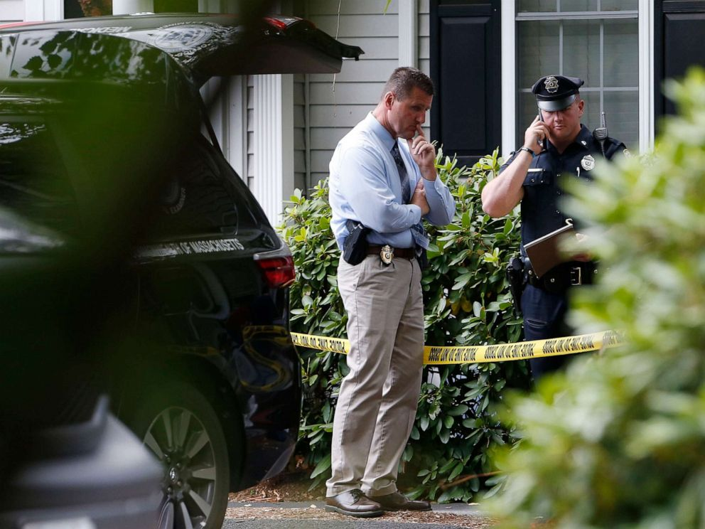 PHOTO: Abington Police Chief David Majenski, left, stands outside of the scene where three children and two adults were found deceased in their home in Abington, Mass. on Oct. 7, 2019.