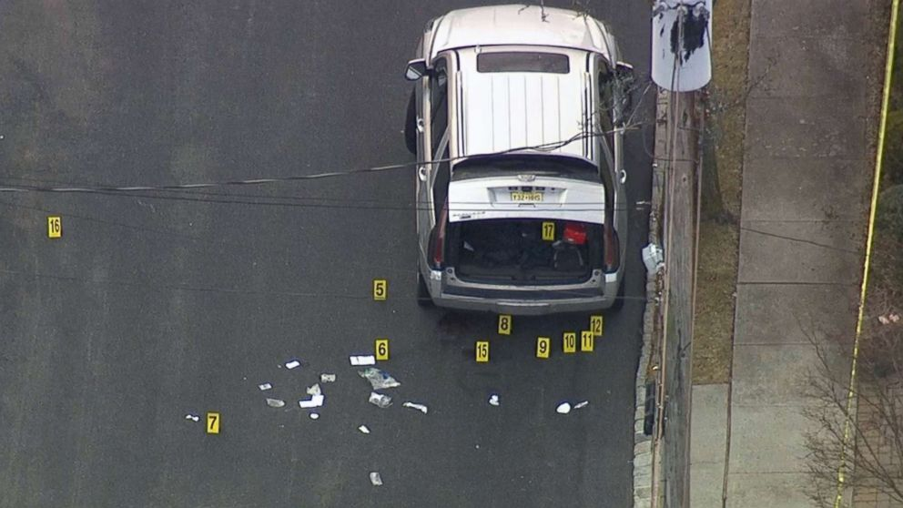 "New York City Police investigate scene on Staten Island where reputed Gambino crime family boss Francesco ""Frankie Boy"" Cali was gunned down outside his house on March 13, 2019."