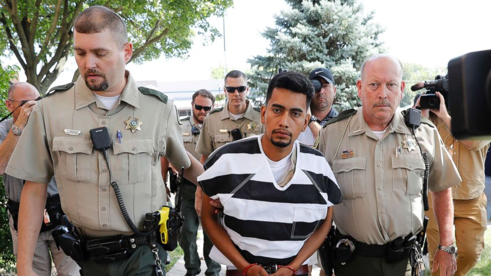 Cristhian Rivera is escorted into the Poweshiek County Courthouse for his initial court appearance, Aug. 22, 2018, in Montezuma, Iowa.