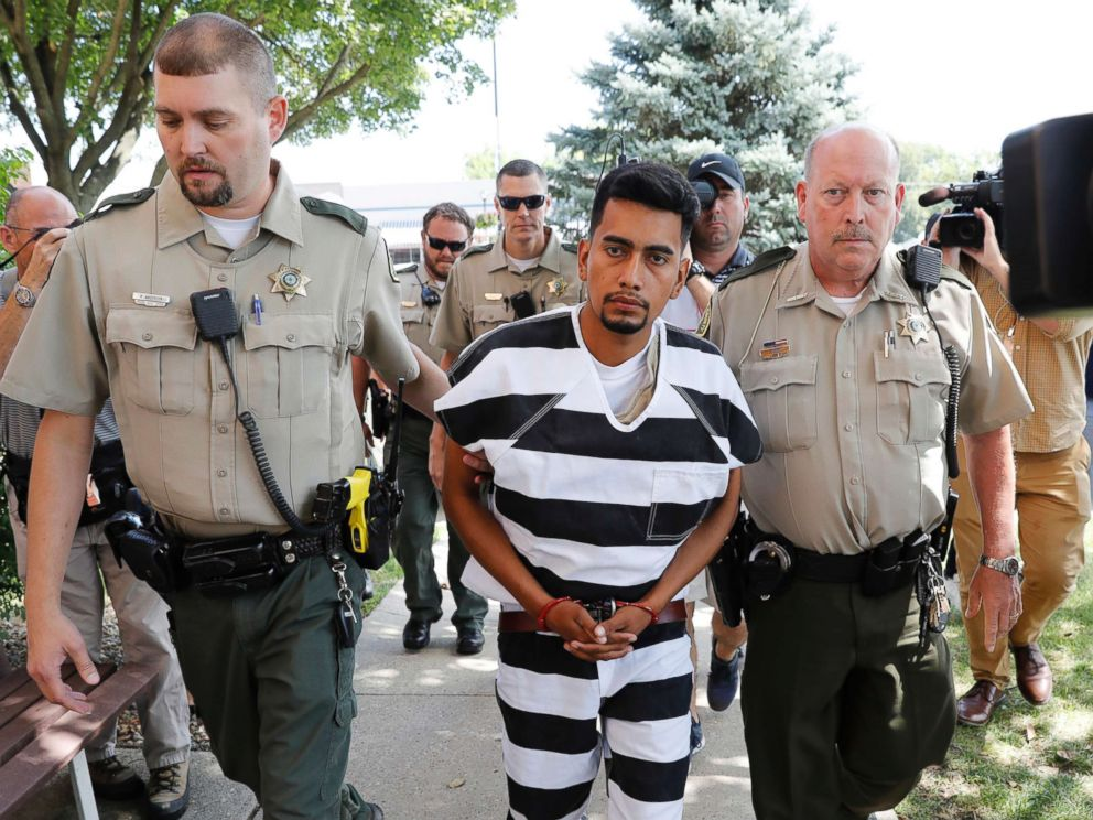 PHOTO: Cristhian Rivera is escorted into the Poweshiek County Courthouse for his initial court appearance, Aug. 22, 2018, in Montezuma, Iowa.