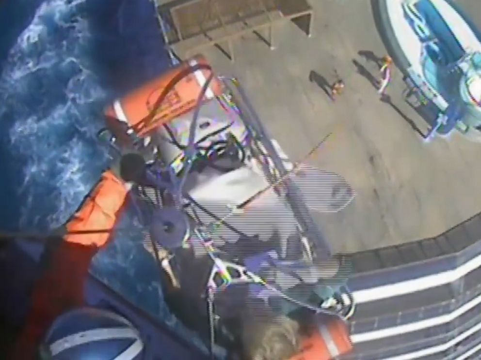 PHOTO: An image made from video shows a crew member from Coast Guard Air Station Savannah airlifting a woman from the Carnival Pride ship on Jan. 30, 2018.