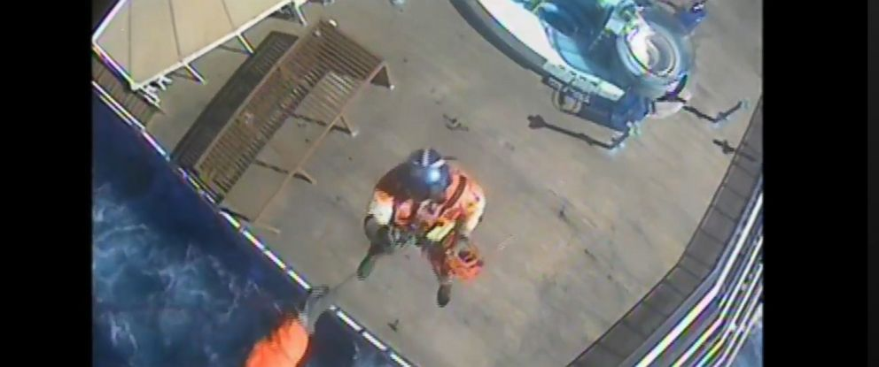 PHOTO: An image made from video shows a crew member from Coast Guard Air Station Savannah during a rescue operation to remove a woman from the Carnival Pride ship on Jan. 30, 2018.