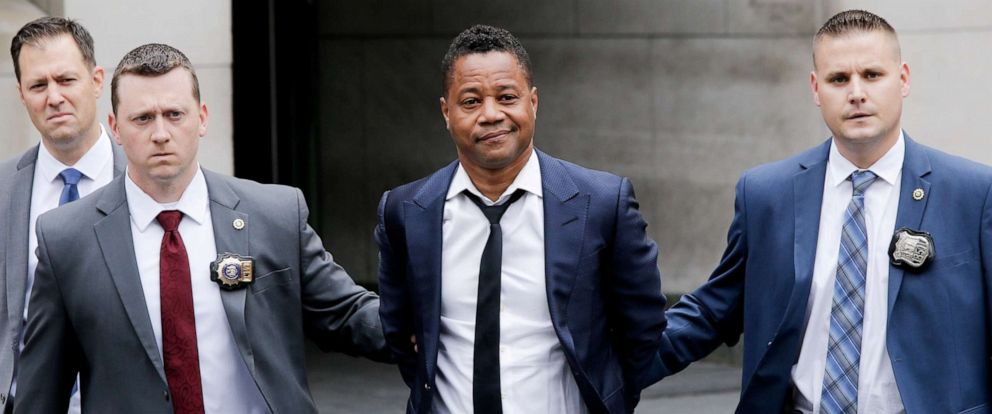 PHOTO:Cuba Gooding Jr. is escorted handcuffed by NYPD officers as he exits the New York City Police Departments Special Victims Division (SVU) in New York, June 13, 2019.