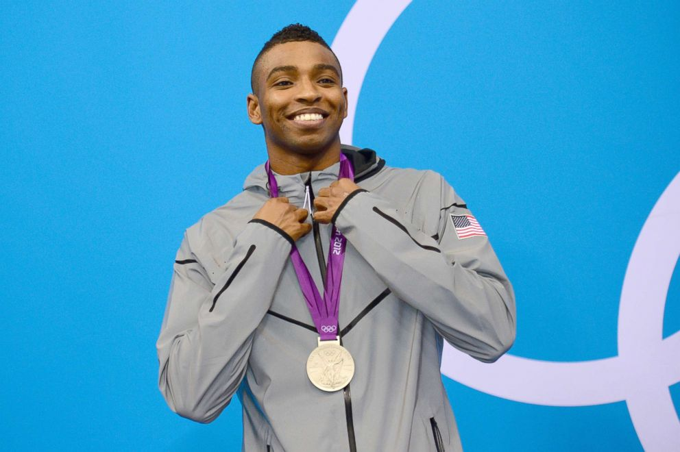 In this file photo, U.S. swimmer Cullen Jones poses on the podium after he won the silver medal in  the men's 50m freestyle final during the swimming event at the London 2012 Olympic Games at the Olympic Park, Aug. 3, 2012, in London.