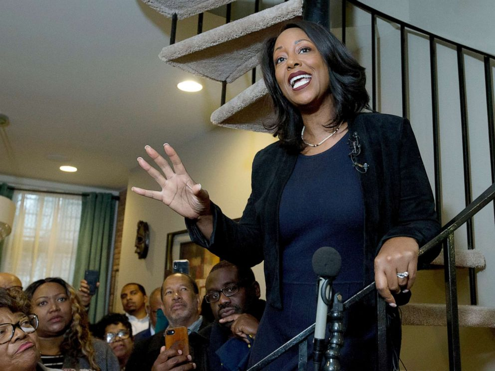 PHOTO: Maya Rockeymoore Cummings speaks to the media and supporters from the stairs of her home announcing her campaign for her late husbands congressional seat, in Baltimore, Nov. 12, 2019.