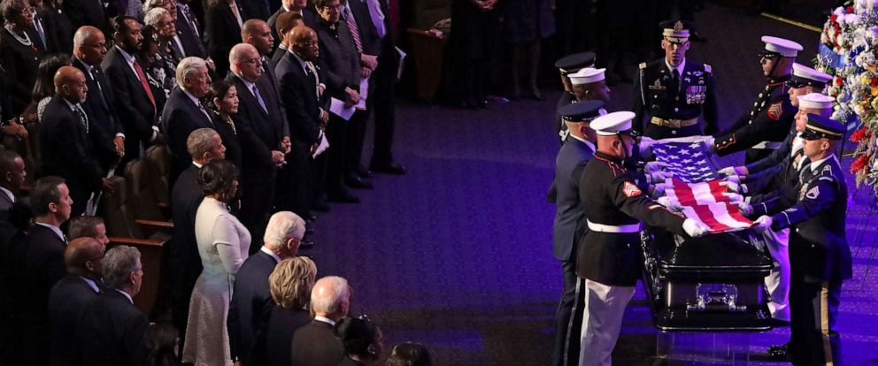 PHOTO: A military honor guard lays the U.S. flag on the casket of Rep. Elijah Cummings during his funeral service at New Psalmist Baptist Church on October 25, 2019, in Baltimore, Maryland.