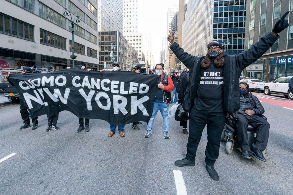 PHOTO: Activists block traffic on Third Avenue outside New York Gov. Andrew Cuomo's office, Wednesday, March 10, 2021, in New York. The activists were demanding Cuomo's immediate resignation.