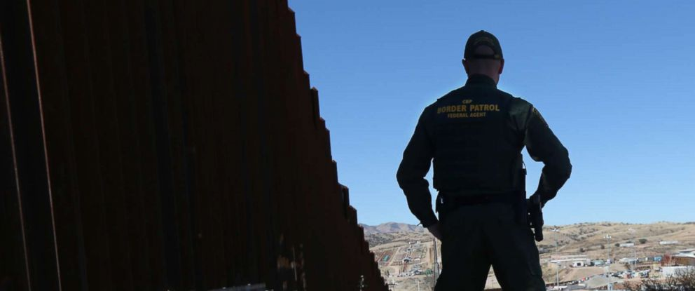 PHOTO: U.S. Customs and Border Protection agents stand at the U.S.-Mexico border fence on Feb. 26, 2013 in Nogales, Ariz.