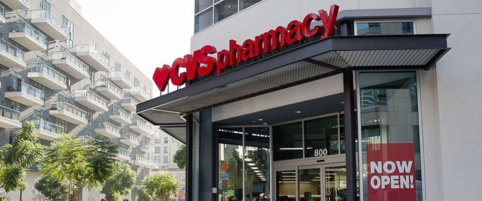 PHOTO: Pedestrians pass in front of a CVS Health Corp. store in downtown Los Angeles, Oct. 27, 2017.