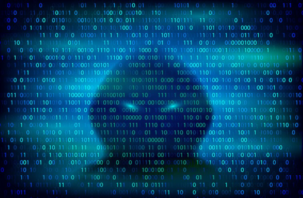PHOTO: A silhouette of a hacker on the background with binary code is pictured in this undated stock photo.