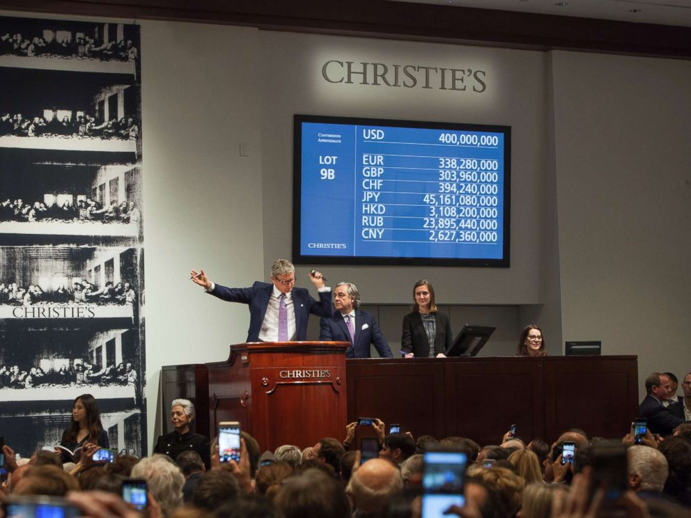 PHOTO: Auctioneer and Global President Jussi Pylkkanen is selling Leonardo da Vincis Salvator Mundi (Savior of the World) painting for $450,312,500 at Christies, Nov. 15, 2017, in New York City.