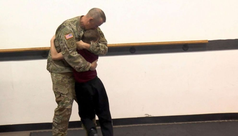 PHOTO: Army Staff Sgt. Ron Cesternino and his son, Luca, hug after he takes his blindfold off and sees his father back home.