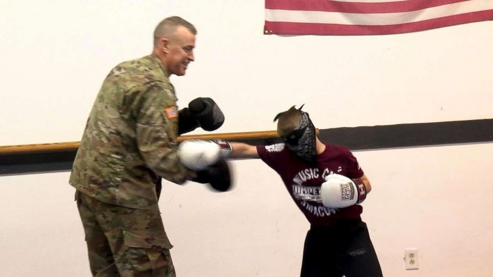 PHOTO: Army Staff Sgt. Ron Cesternino spars with his son at his taekwondo class during surprise homecoming.