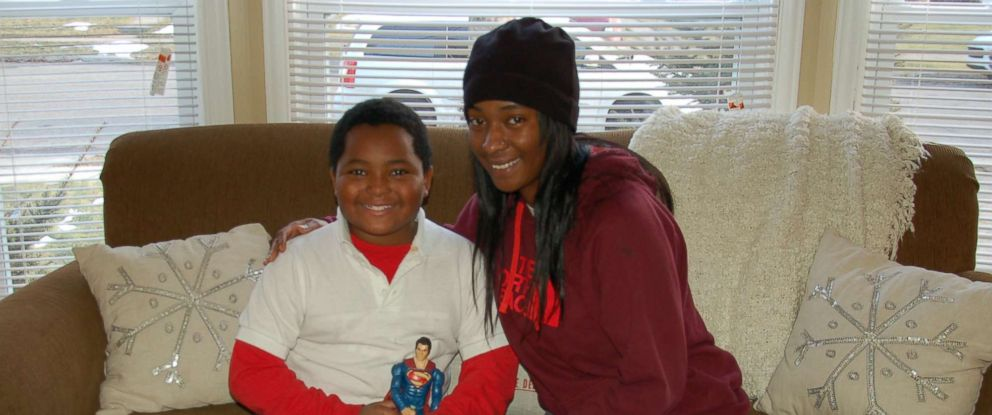 PHOTO: Daerye, 8, and his mother, Dionna Neely, of Detroit, Michigan, in their new home. Their home was furnished and decorated for free by Humble Design, a charity that helps the formerly homeless.