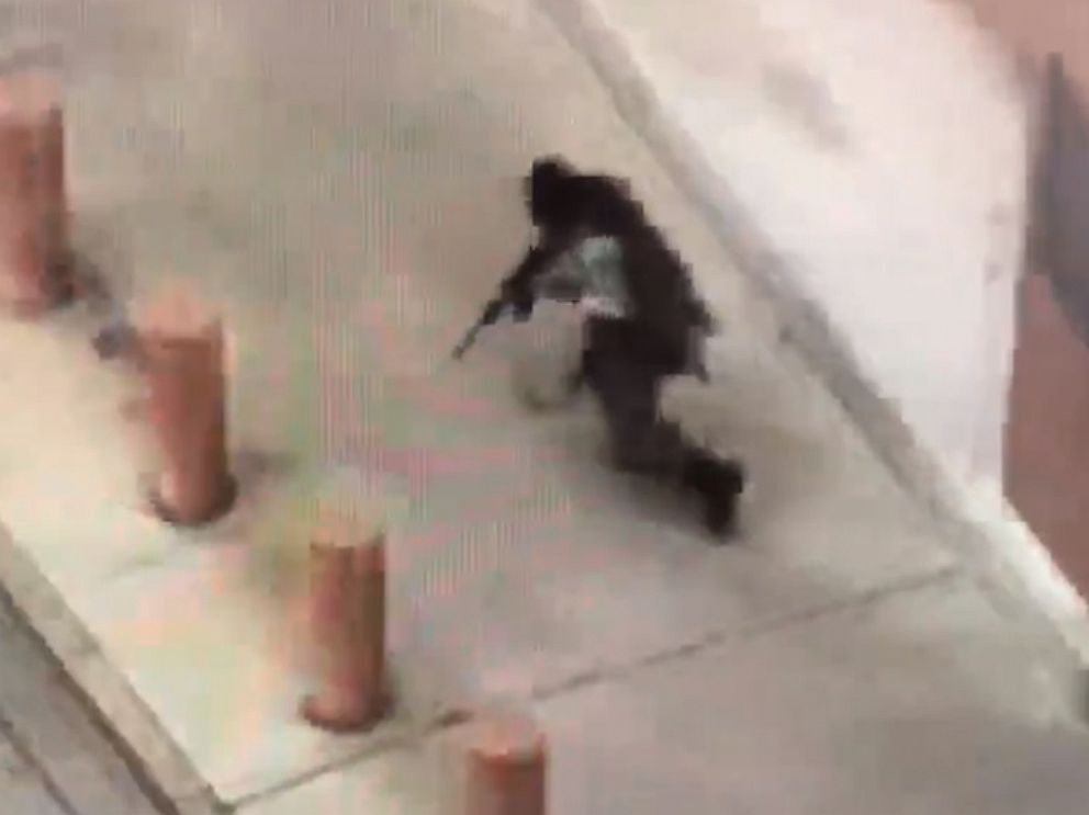 PHOTO: Cell-phone video taken by a witness appears to show a gunman dressed in tactical gear firing an assault rifle outside the Earle Cabell federal courthouse in Dallas on June 17, 2019.