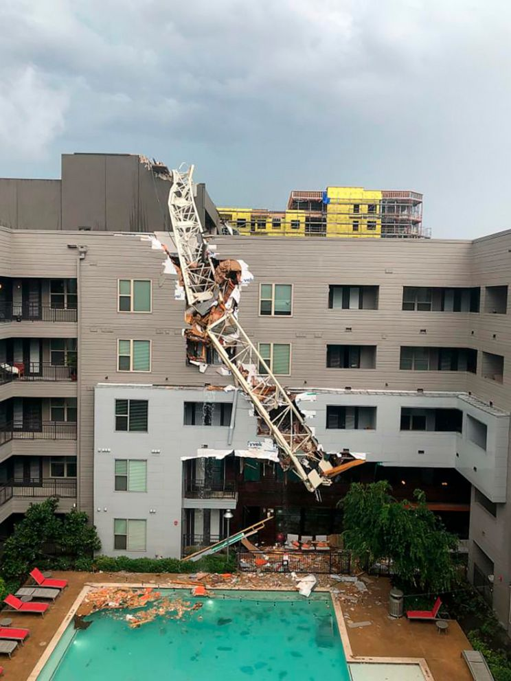 PHOTO: This photo provided by Michael Santana shows the scene after a crane collapsed into Elan City Lights apartments in Dallas amid severe thunderstorms Sunday, June 9, 2019.