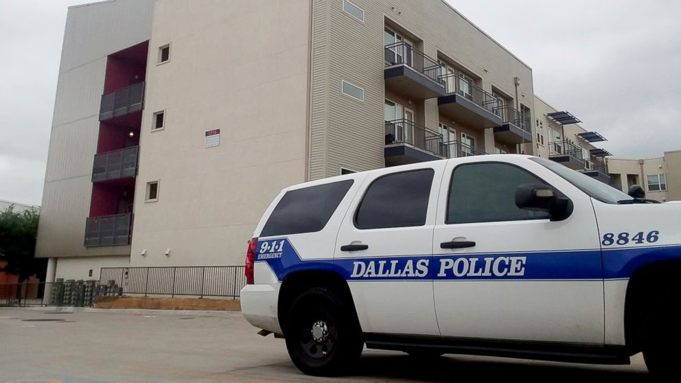 A Dallas Police vehicle is parked near the South Side Flats apartments in Dallas, Sept. 10, 2018.