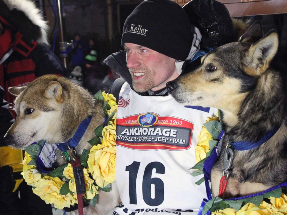 PHOTO: Dallas Seavey poses with his lead dogs Reef, left, and Tide after finishing the Iditarod Trail Sled Dog Race in Nome, Alaska in this March 15, 2016 file photo.