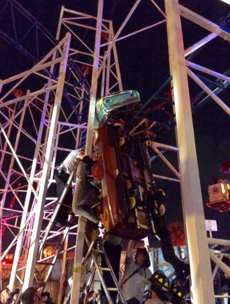 PHOTO: Firefighters work to rescue riders trapped in a derailed roller coaster car in Daytona Beach, Fla.