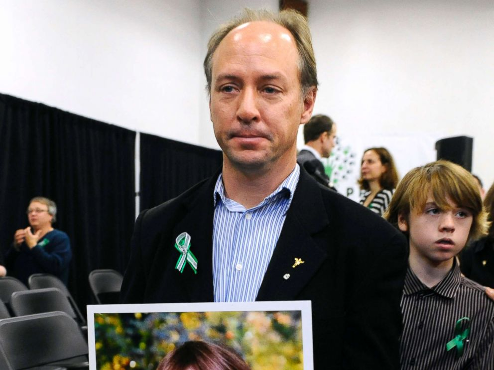 PHOTO: Mark Barden, father of Sandy Hook Elementary School shooting victim Daniel Barden holds a photograph of his son as he leaves a news conference at Edmond Town Hall in Newtown, Conn., Jan. 14, 2013.