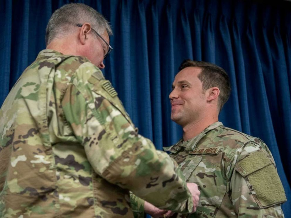 PHOTO: Staff Sgt. Daniel P. Keller (right), receives the Bronze Star Medal from Col. David Mounkes, commander of the 123rd Airlift Wing, at the Kentucky Air National Guard Base in Louisville, Ky., Nov. 17, 2018.