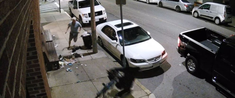 PHOTO: Surveillance video shows Danny Morris arriving at his market and confronting two robbers.