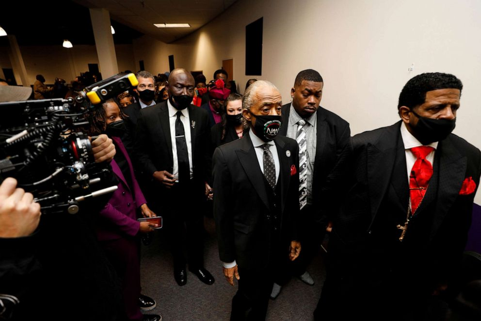PHOTO: Rev. Al Sharpton and Civil Rights attorney Ben Crump pay their respects for Daunte Wright at his funeral at Shiloh Temple International Ministries in Minneapolis, April 22, 2021.