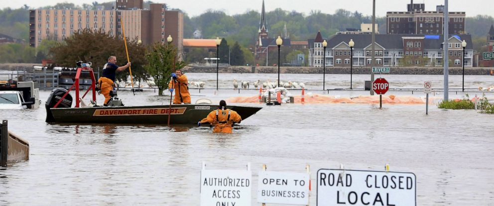 PHOTO: Davenport firefighters search the area after the floodwall failed at River Drive and Pershing Avenue sending Mississippi River floodwater into several blocks of downtown Davenport, Iowa Tuesday, April 30, 2019.