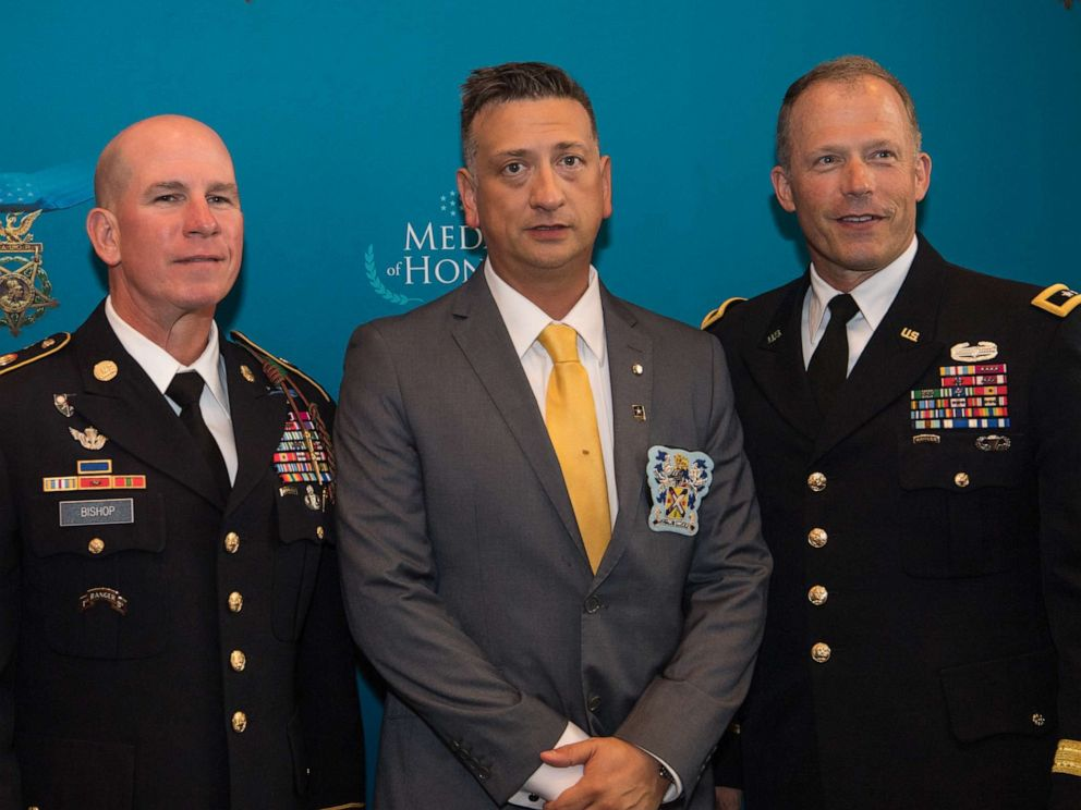 PHOTO: Former U.S. Army Staff Sgt. David G. Bellavia, center, attends a Medal of Honor reception at the Sheraton Pentagon City Hotel, Arlington, Va., June 24, 2019.