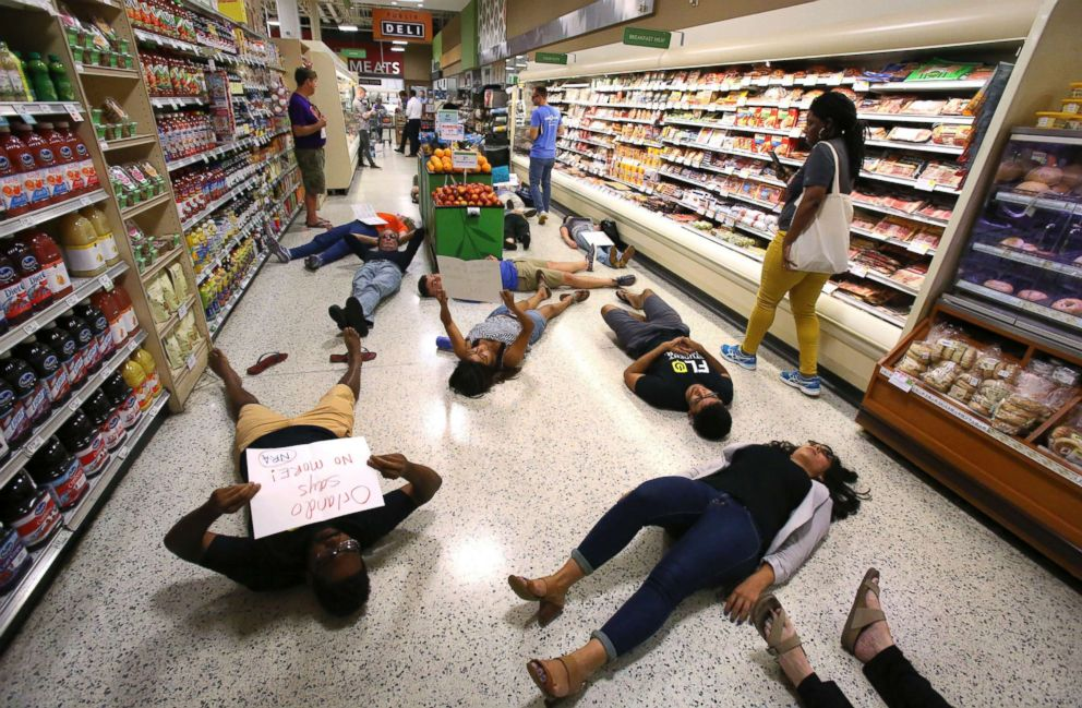 PHOTO: Demonstrators lie on the floor during a protest against gun violence, at the Publix store on East Colonial Drive near downtown Orlando, Fla., on May 25, 2018.