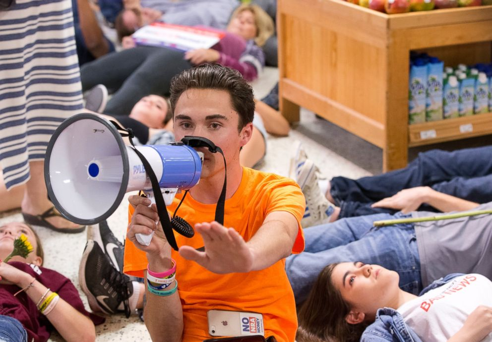 PHOTO: Marjorie Stoneman Douglas High School student David Hogg speaks as demonstrators lie on the floor at a Publix Supermarket in Coral Springs, Fla., May 25, 2018.