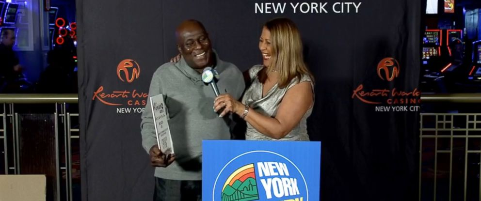 PHOTO: David Johnson, 56, of East New York, accepted his winnings from Yolanda Vega of the New York Lottery Friday at Resorts World Casino in Queens, Jan. 25, 2019.