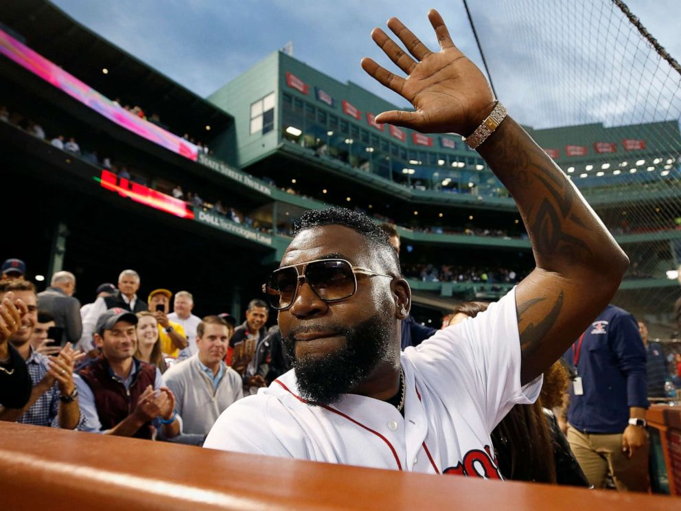PHOTO: Former Boston Red Soxs David Ortiz waves to the crowd after throwing out a ceremonial first pitch before a baseball game against the New York Yankees in Boston, Sept. 9, 2019.