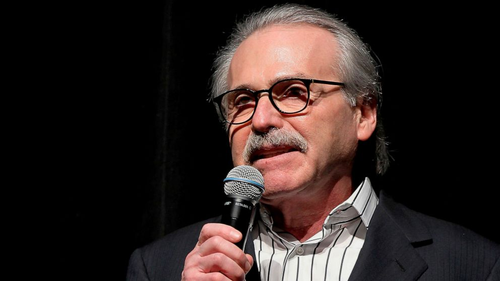 "In this Jan. 31, 2014 photo, David Pecker, chairman and CEO of American Media, addresses those attending the Shape & Men's Fitness Super Bowl Party in New York. The parent company of the National Enquirer said Wednesday, April 10, 2019, that it is exploring a possible sale as part of a ""strategic review"" of its tabloid business. The decision by American Media comes after the tabloid said it paid $  150,000 to keep Karen McDougal quiet about an alleged affair with Trump and being accused by Amazon chief Jeff Bezos of blackmail."