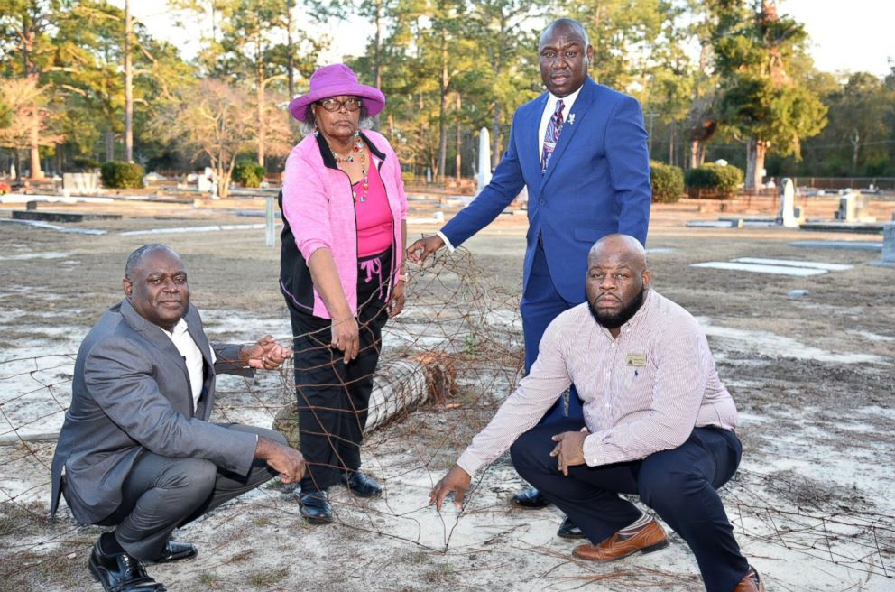 PHOTO: From left, Mayor Rufus Davis, Priscilla Davis, Ben Crump and Councilman Venterra Pollard stand at the site of the fence that once marked the segregation of blacks from whites at Oakview Cemetery in Camilla, Ga., Jan. 11, 2018.