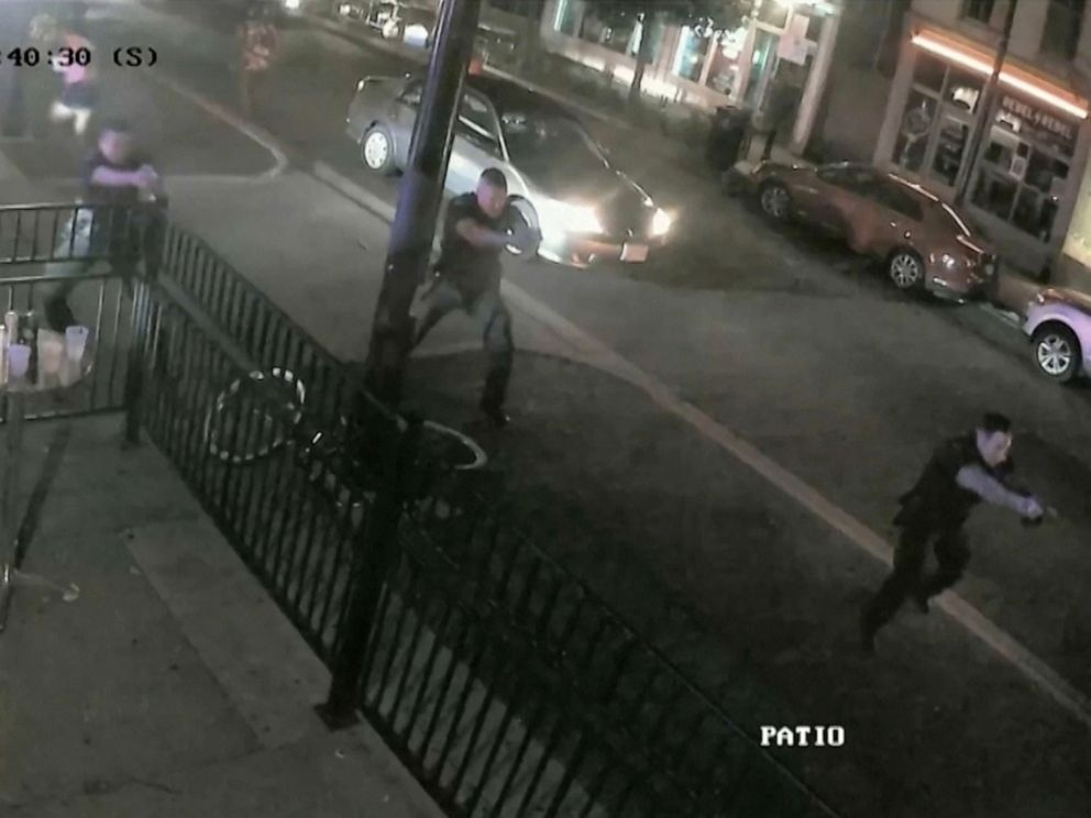 PHOTO: Police officers approach the scene of a mass shooting with weapons drawn in a still image from surveillance video released by police in Dayton, Ohio, Aug. 4, 2019.