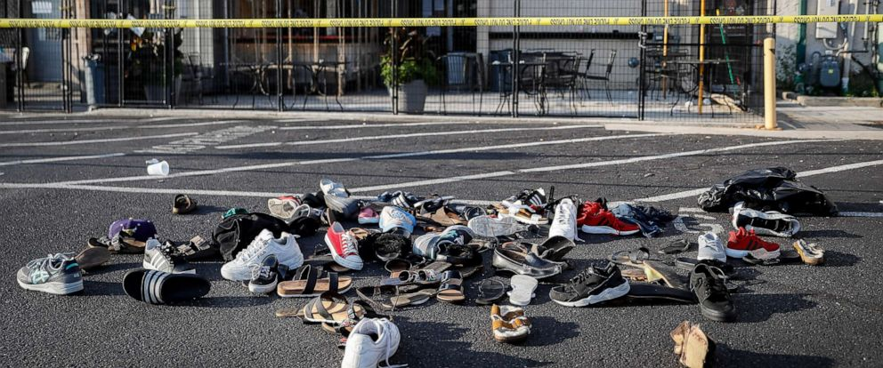 PHOTO: Shoes are piled outside the scene of a mass shooting including Ned Peppers bar, Aug. 4, 2019, in Dayton, Ohio. Several people in Ohio have been killed in the second mass shooting in the U.S. in less than 24 hours.