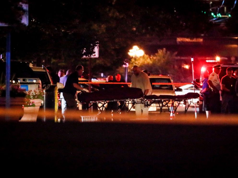 PHOTO: Bodies are removed from at the scene of a mass shooting, Sunday, Aug. 4, 2019, in Dayton, Ohio.