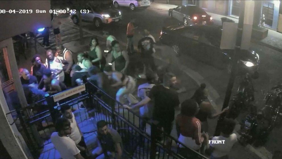 PHOTO: People react to a gunman in a still image from surveillance video released by police in Dayton, Ohio, Aug. 4, 2019.