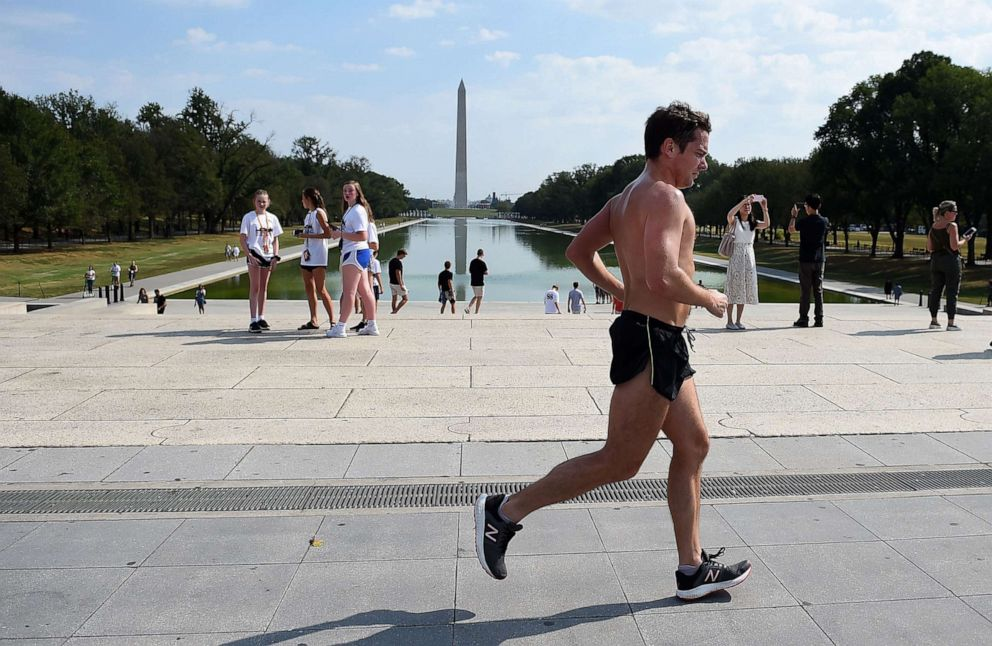 PHOTO: A man runs pass the Lincoln Memorial on the National Mall as temperatures are expected to soar into mid-90s (32C), on October 2, 2019, in Washington, DC.