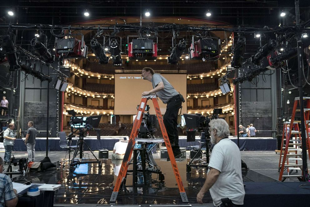 PHOTO: Workers assemble the television set inside the media filing center at Adrienne Arsht Center for the Performing Arts where the first Democratic presidential primary debates for the 2020 elections will take place, June 25, 2019 in Miami.