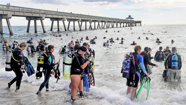 Divers pull 1,200 pounds of lead fishing weight out of the ocean on Florida beach