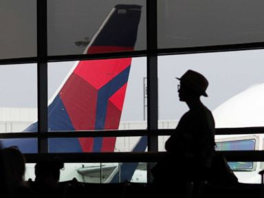 PHOTO: A passengers waits for a Delta Airlines flight in Terminal 5 at Los Angeles International Airport, May 4, 2017 in Los Angeles.