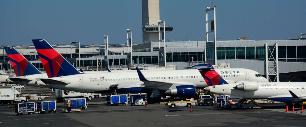 PHOTO: In this September 24, 2017, file photo, Delta Airlines Boeing 777 passenger jets are shown being serviced at John F. Kennedy International Airport in New York.