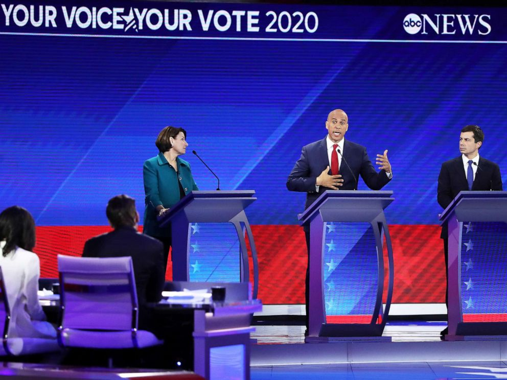 PHOTO: Democratic presidential candidate Sen. Amy Klobuchar and Mayor Pete Buttigieg look on as Sen. Cory Booker speaks during the Democratic Presidential Debate on Sept. 12, 2019, in Houston.