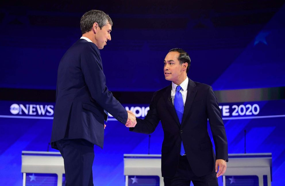 PHOTO: Democratic presidential hopefuls Former Texas Representative Beto ORourke and Former housing secretary Julian Castro shake hands as they arrive on stage for the third Democratic primary debate in Houston, Sept. 12, 2019.
